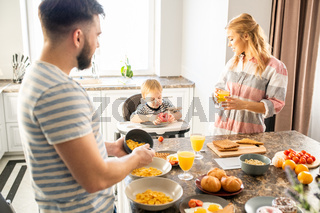 Young  Family Enjoying Breakfast with Baby