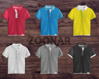 Collection of colorful t-shirts on wooden background