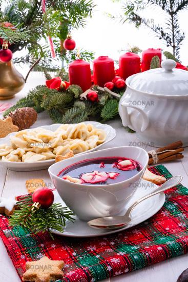 Barszcz (beetroot soup) with small pierogi