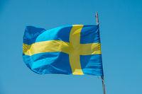 Swedish flag waving on blue sky - flag of Sweden