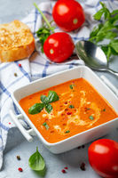 Spicy tomato soup with green basil.