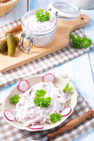 delicious homemade meat salad with mayonnaise and cucumber