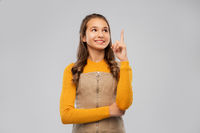 smiling young teenage girl pointing finger up