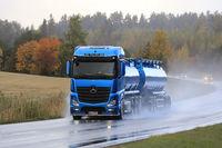 Blue Mercedes-Benz Tanker Trucking in Rain