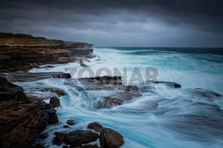 Wild weather at Cape Banks rocky escarpment
