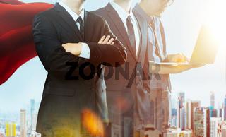 Superhero businessman team standing together