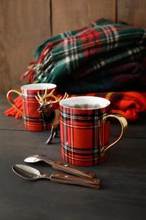 Mugs with hot tea on wood table