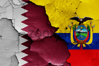 flags of Qatar and Ecuador painted on cracked wall