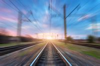 Railway station with motion blur effect. Blurred railroad