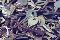 Many of the vintage keys to a door and furniture