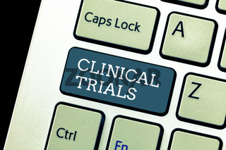 Writing note showing Clinical Trials. Business photo showcasing Research investigation to new treatments to showing