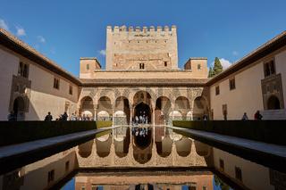 People visiting courtyard of the Myrtles (Patio de los Arrayanes) in La Alhambra, Granada, Spain