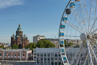 Ferris wheel and Uspenski Cathedral, an Eastern Orthodox cathedral in  Helsinki, Finland