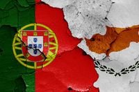 flags of Portugal and Cyprus painted on cracked wall