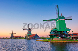 Windmills at Zaanse Schans in Holland on sunset. Zaandam, Netherlands