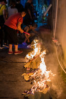 People burning paper in a religious festival ceremony