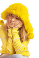 Beautiful pensive young woman in yellow fur hat