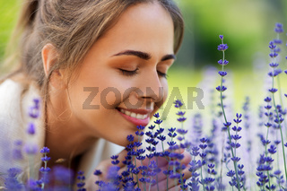 close up of woman smelling lavender flowers