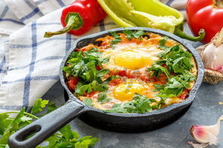 Shakshuka in a cast iron pan.