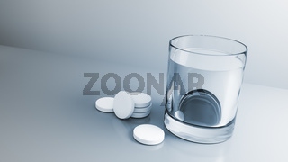 glass of water with some tablets