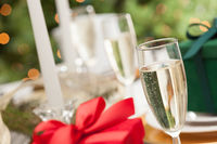 Champagne Glass and Christmas Gift with Place Setting Abstract at Table