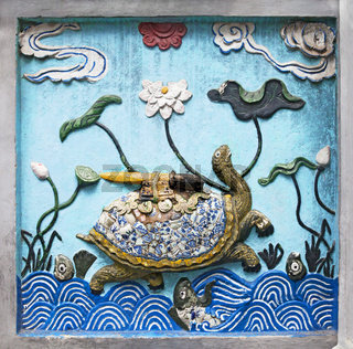 Hanoi, VIETNAM - JANUARY 12, 2015 - Ceramic decoration of entrance in Ngoc Son temple, Hanoi