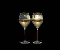 Two champagne flute glasses marina sunset isolated on black