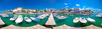 Krk. Town of Malinska harbor and turquoise waterfront panoramic view