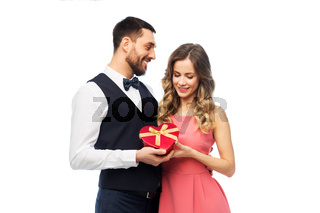 happy couple with gift on valentines day