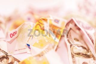 Fake dollars and euro crumpled money background