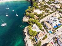 Coast of Porto Cristo with villas and natural harbor