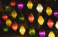 Beautiful decoration lanterns light on night market in Hoi An, Vietnam.