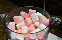 white and pink marshmallows in glassware