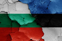 flags of Bulgaria and Estonia painted on cracked wall