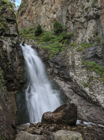 Closeup view of waterfall scenes in mountains, national park Dombay, Caucasus