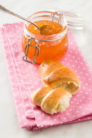 Apricot jam jelly and croissants.