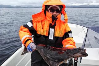 Angler mit Heilbutt