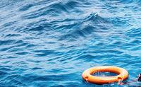orange lifebuoy ring stormy sea.