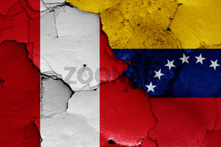 flags of Peru and Venezuela painted on cracked wall