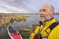 senior SUP paddler environmental  portrait