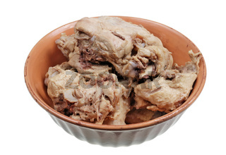 Chunks of boiled chicken bones with meat  isolated macro