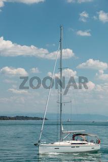 Nice little sailboat on a lake near the coast