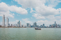 fisher boat with modern skyscraper city skyline background - Panama City -