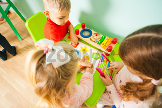 Children playing with music and mathematics toys