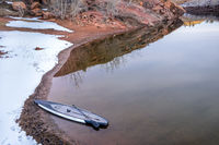 winter stand up paddling on lake in Colorado