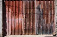 rusty metal gate, vintage iron door, house / garage -