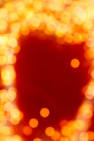 Glamorous golden shiny glitter on red abstract background, Christmas, New Years and Valentines Day backdrop, bokeh overlay for luxury holidays brand design