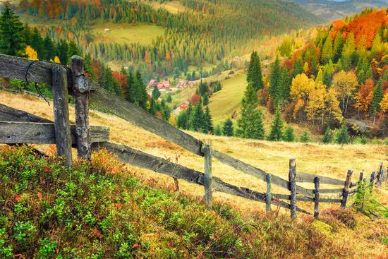 Colorful autumn landscape scene with fence in Transylvania