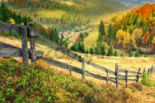 Colorful autumn landscape scene with fence in Transylvania