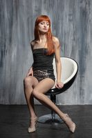 Lovely lady posing sitting on a chair